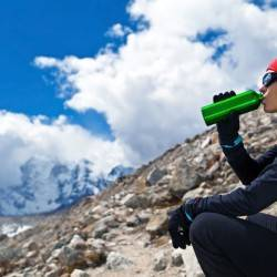 Young woman hiking on glacier in Himalaya Mountains in Nepal